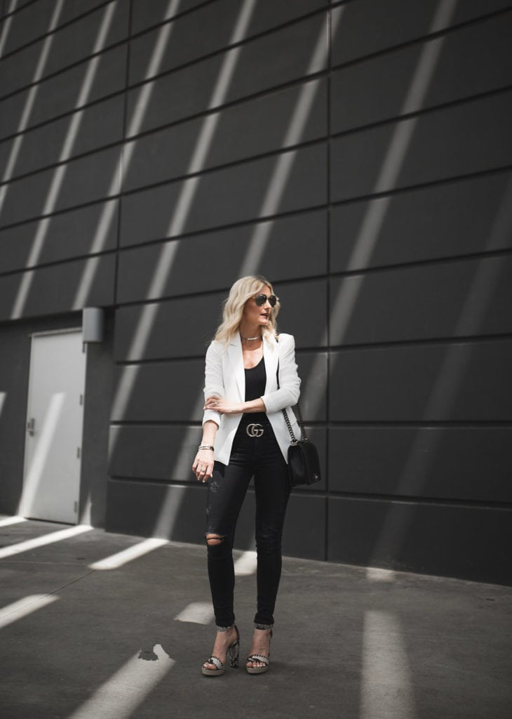White blazer and black ripped jeans