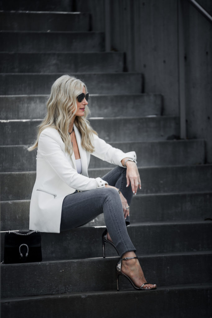 Veronica Beard white blazer and gray skinny jeans