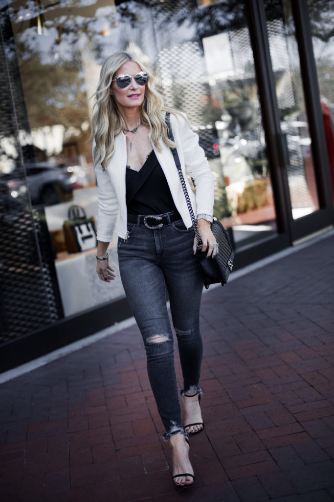 Dallas Fashion Blogger wearing white jacket and ripped jeans