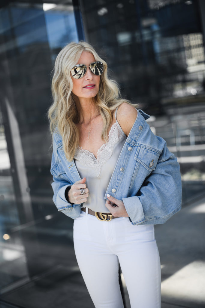 Dallas Fashion blogger wearing white jeans and denim jacket