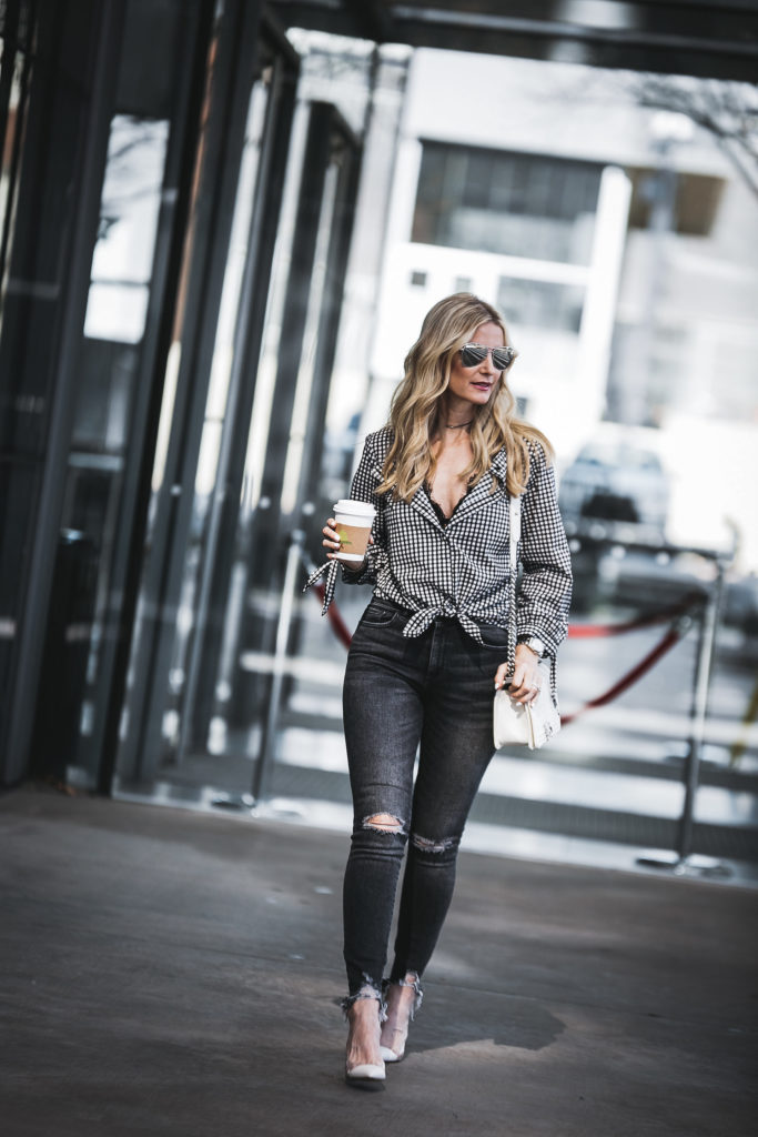 Dallas Fashion Blogger wearing ripped jeans and white heels