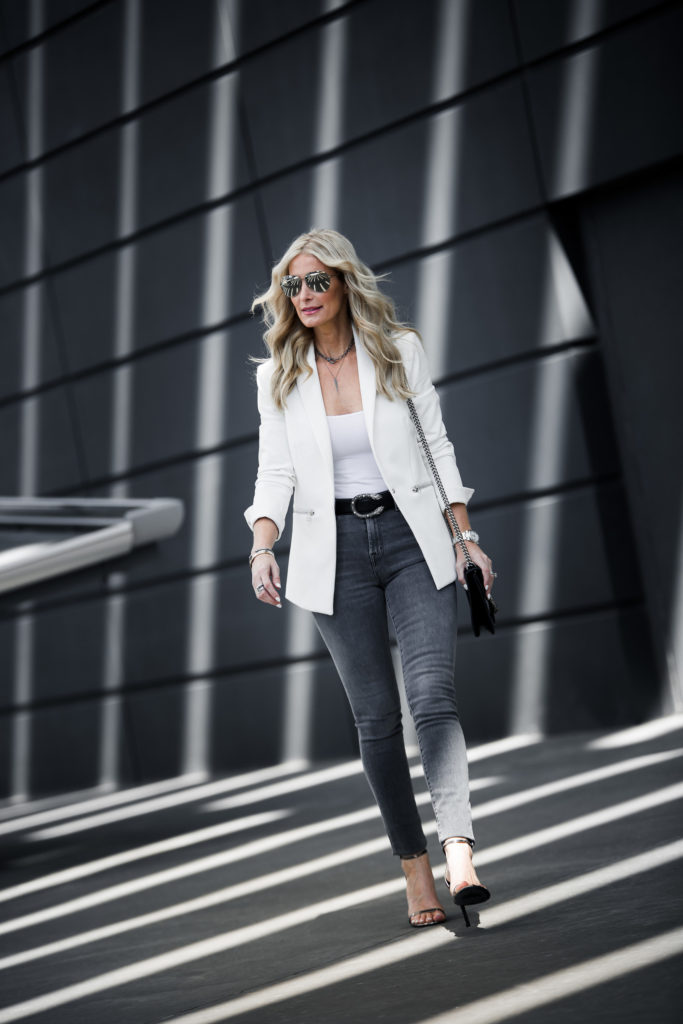Dallas style blogger wearing white blazer and silver heels