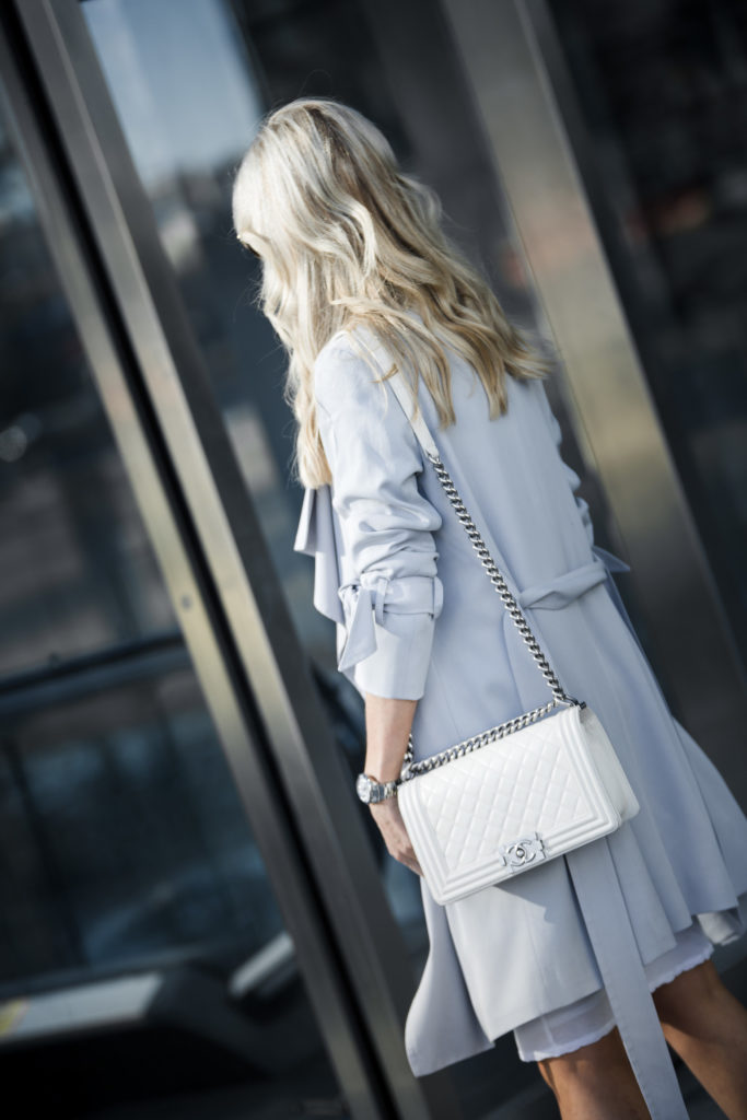 White Chanel boy bag plus chic trench coat