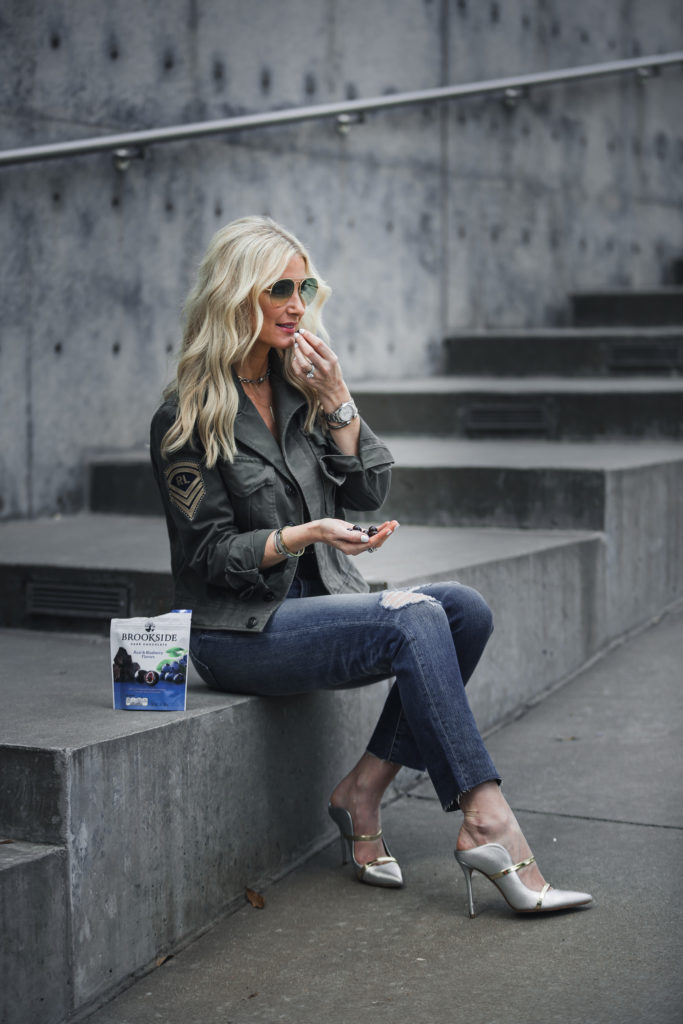 Heather Anderson wearing army jacket and heels