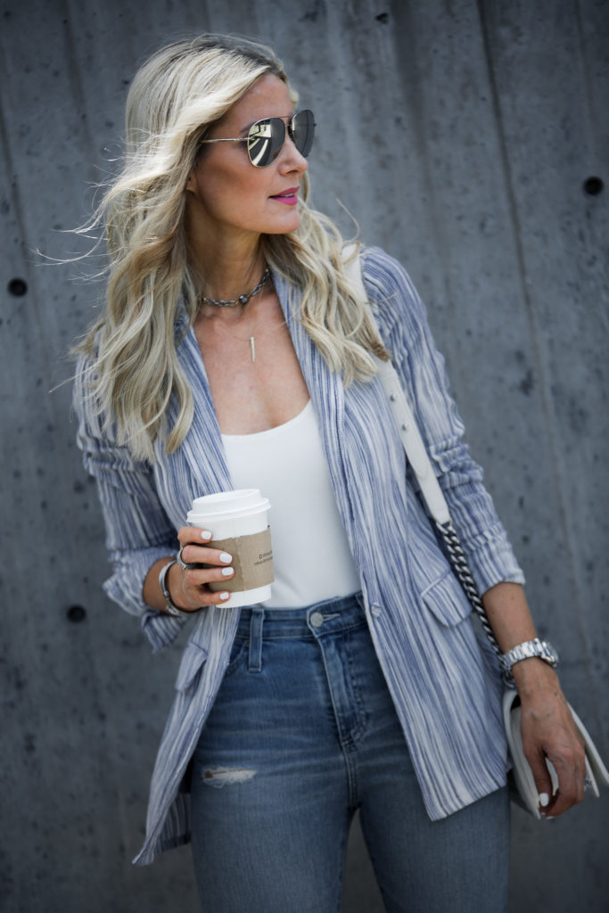 Dallas Fashion Blogger wearing ripped and striped blazer