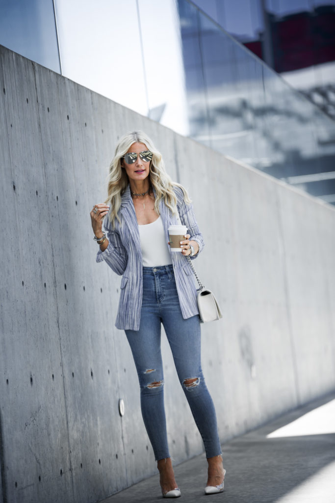 Heather Anderson wearing blazer, white pumps, and ripped jeans