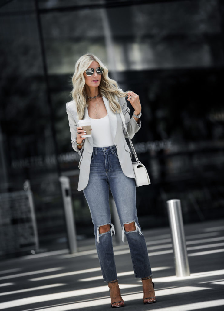 Blonde girl weairng L'agence ripped jeans and blazer