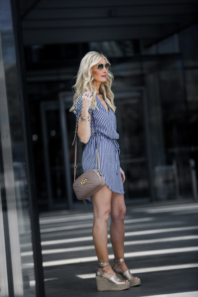 Striped dress paired with a crossbody Gucci Bag