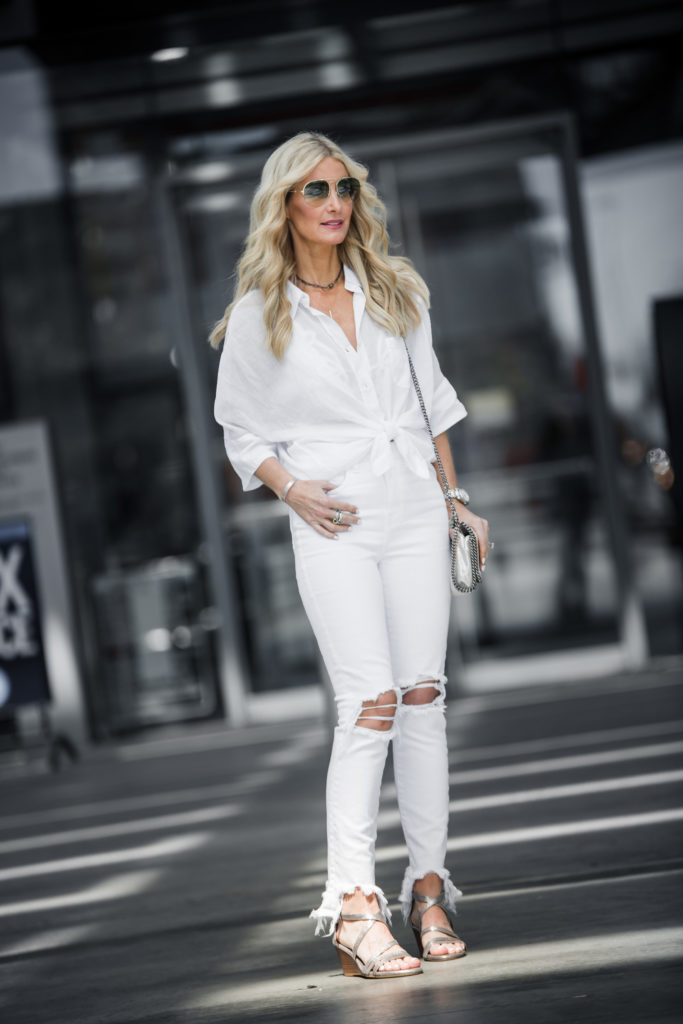 Heather Anderson wearing white ripped jeans
