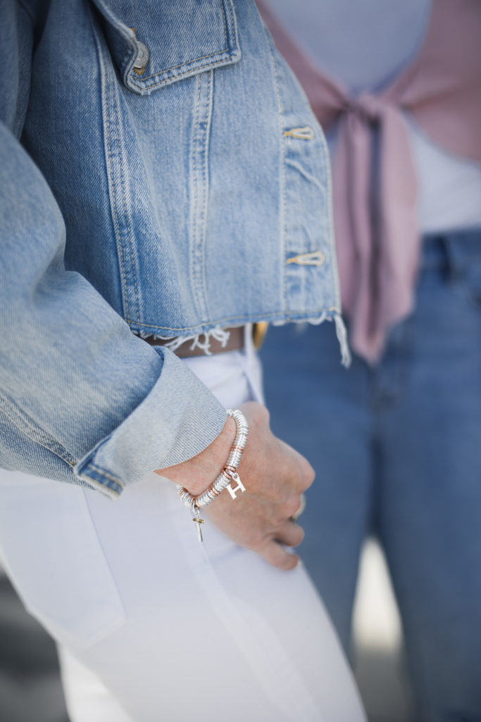 Heather Anderson Wearing Silver Charm Bracelet and Denim Jacket