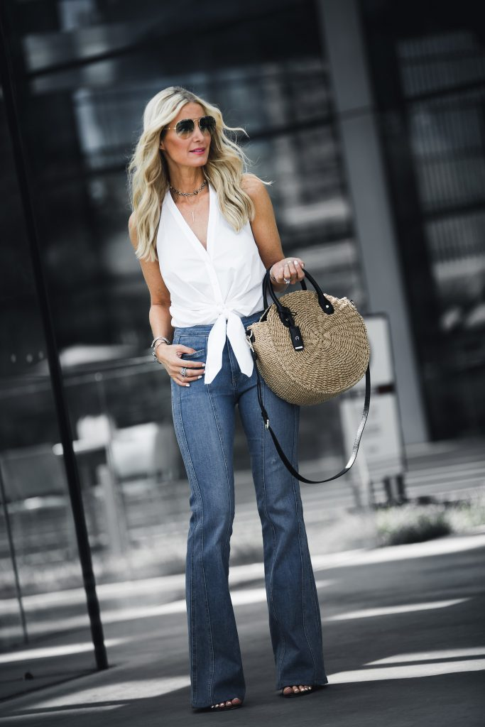 Dallas blonde girl wearing white halter top and jeans