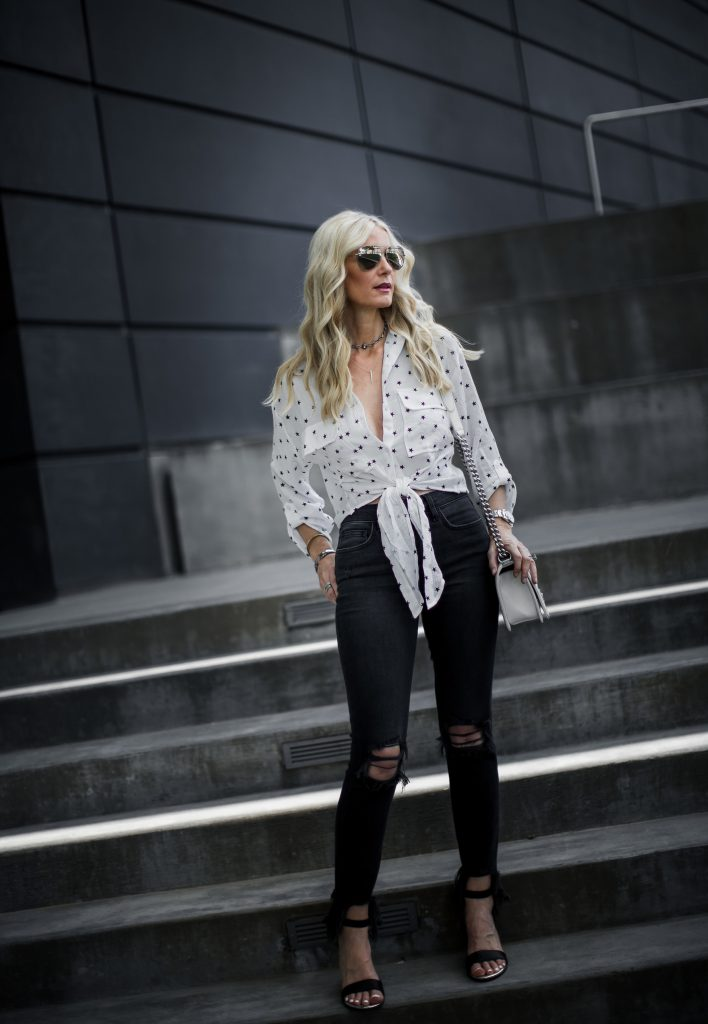 Dallas Fashion Blogger wearing black ripped jeans