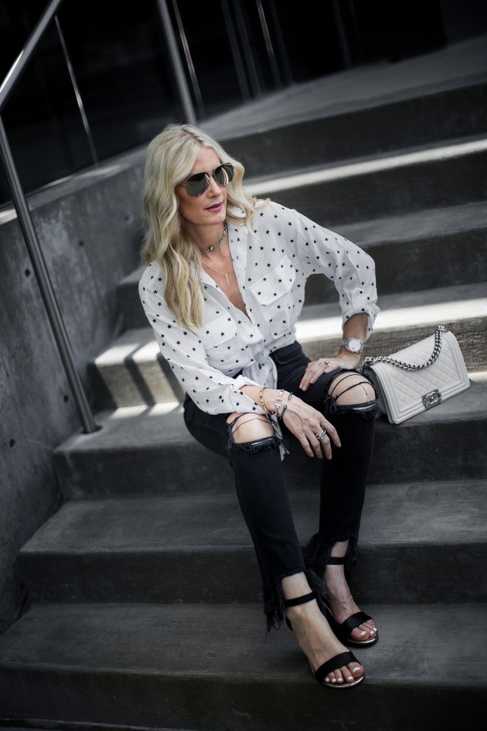 Dallas Blonde wearing ripped jeans and wedges