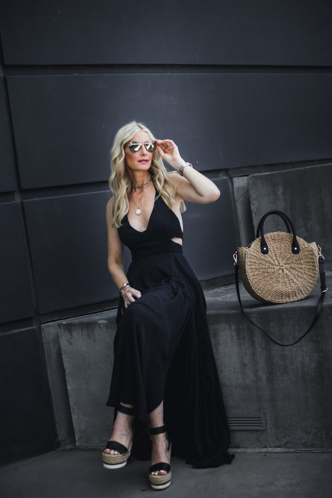 black maxi dress, wedges, and straw bag