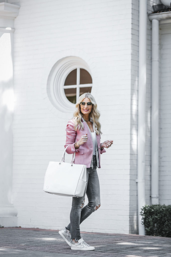 Heather Anderson carrying a white travel bag
