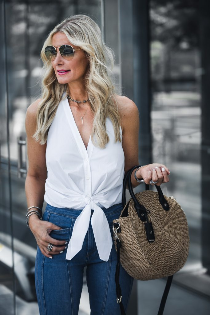 Dallas fashion blogger wearing white top and jeans