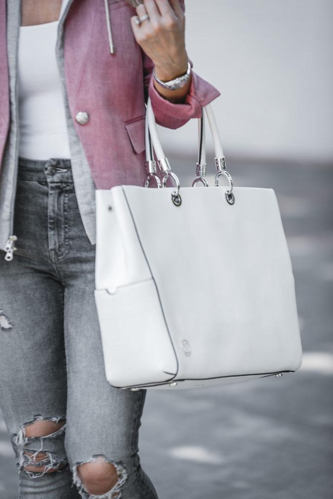 White Travel Handbag + Blazer + Ripped Jeans