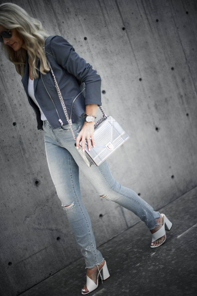 Dior handbag and ripped jeans