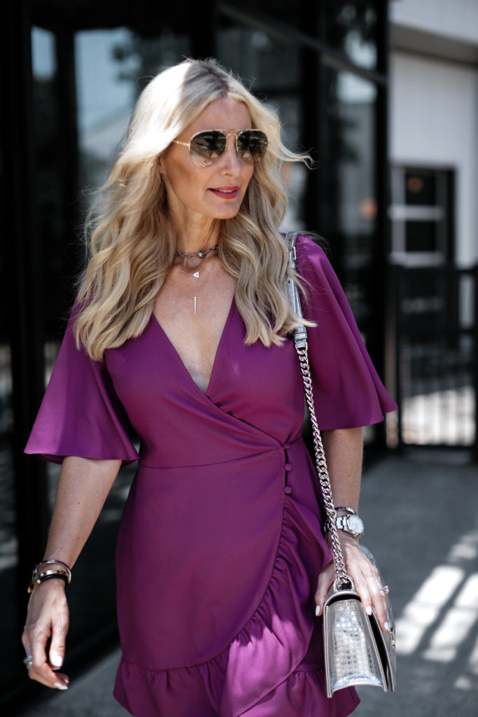 Dallas fashion blogger wearing a pink wrap dress