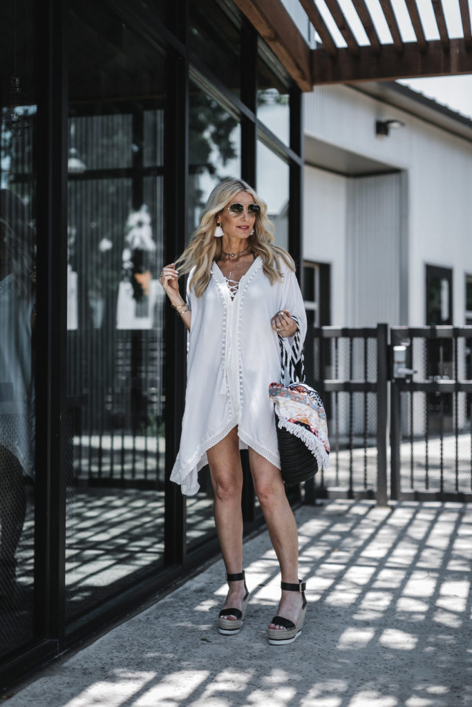 Dallas blonde wearing white beach cover-up