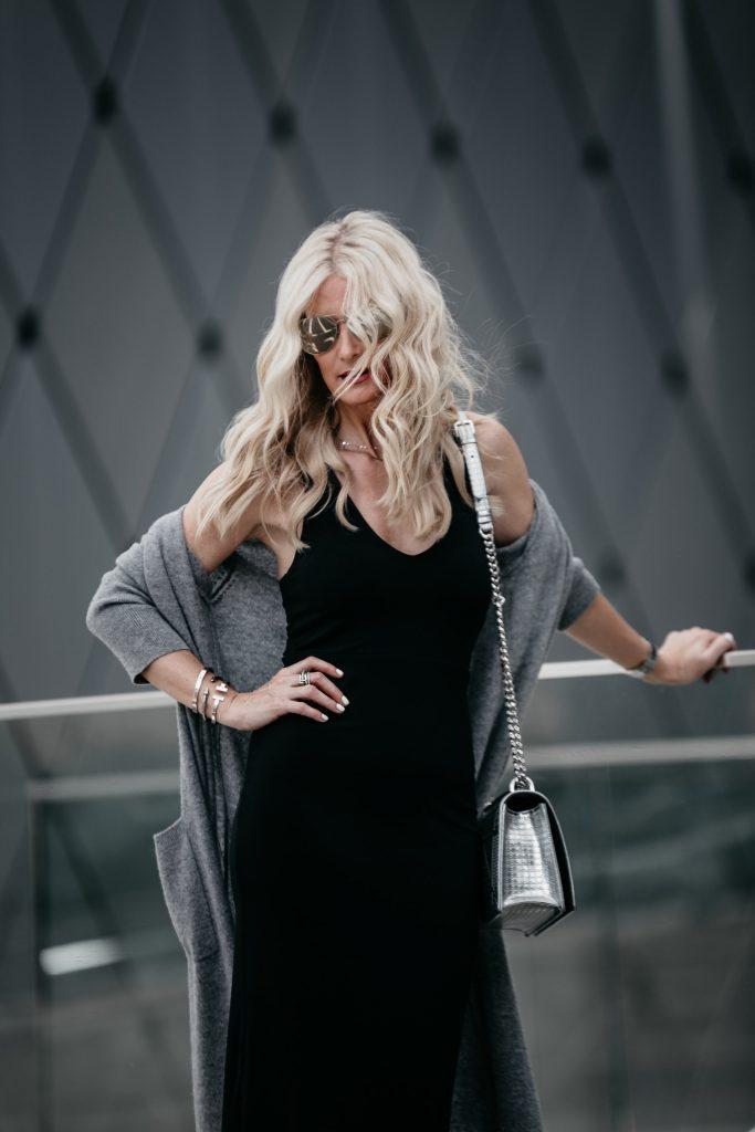 black midi dress and gray cashmere cardigan