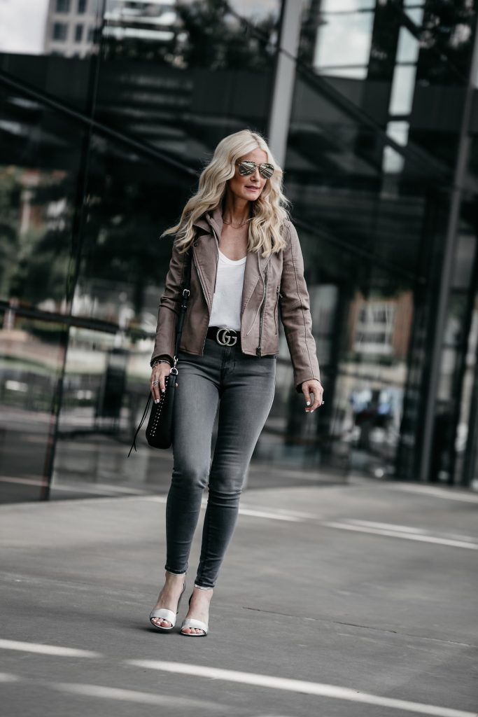 Dallas fashion blogger wearing gray skinny jeans and moto jacket