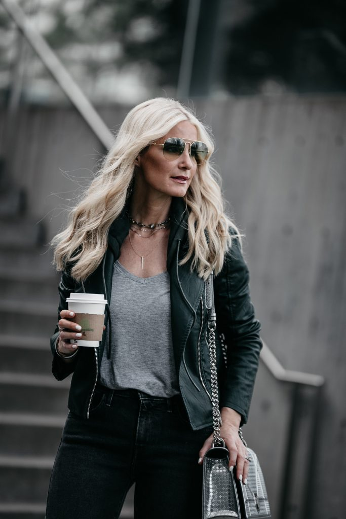 Dallas blonde girl wearing faux leather jacket