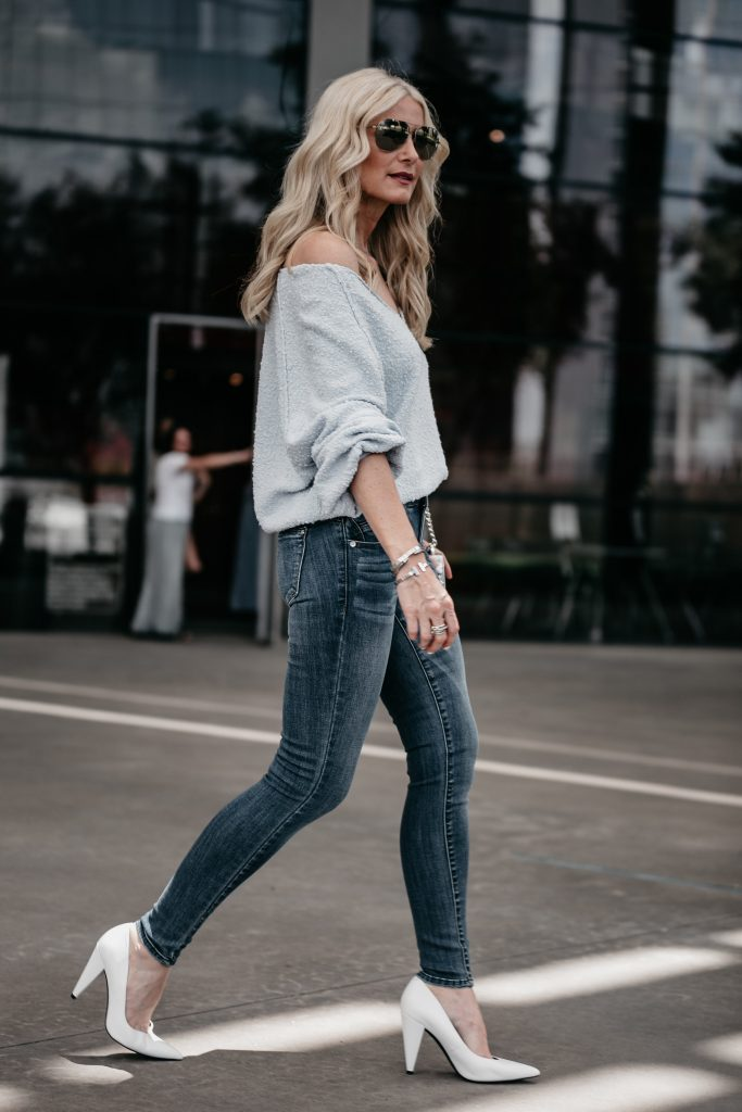 Dallas fashion blogger wearing blue jeans and white pumps