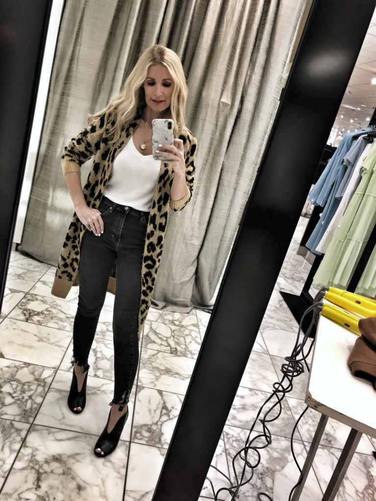 Dallas woman wearing a leopard cardigan and black jeans