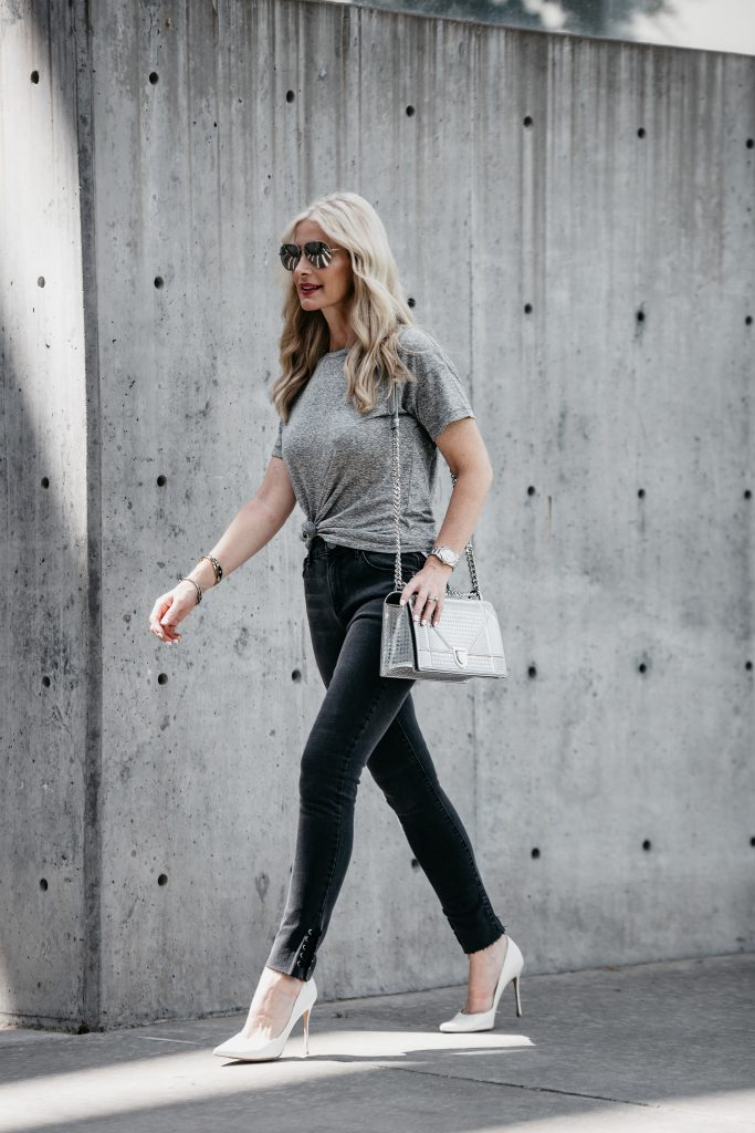 Dallas style blogger wearing black jeans and white pumps