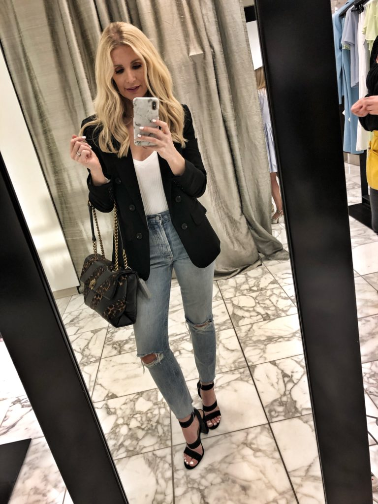 Dallas influencer wearing a black blazer and ripped jeans