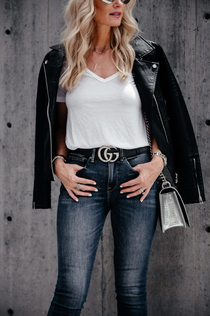 Black leather jacket, white tee, and jeans
