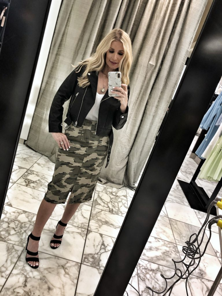 Dallas influencer wearing a camo midi skirt and a leather jacket