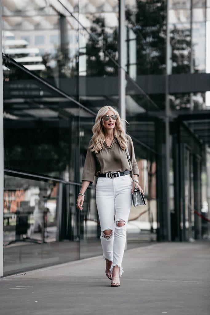 Ivanka Trump top, white jeans, and Gucci belt