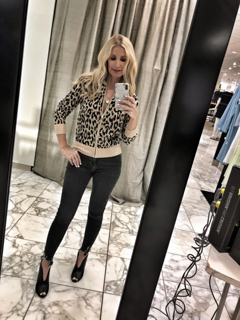 Dallas woman wearing a leopard sweater and Topshop jeans