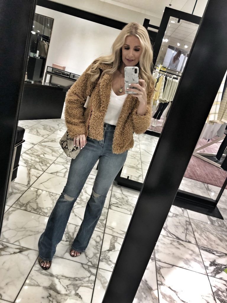 Dallas influencer wearing Good American Flare jeans