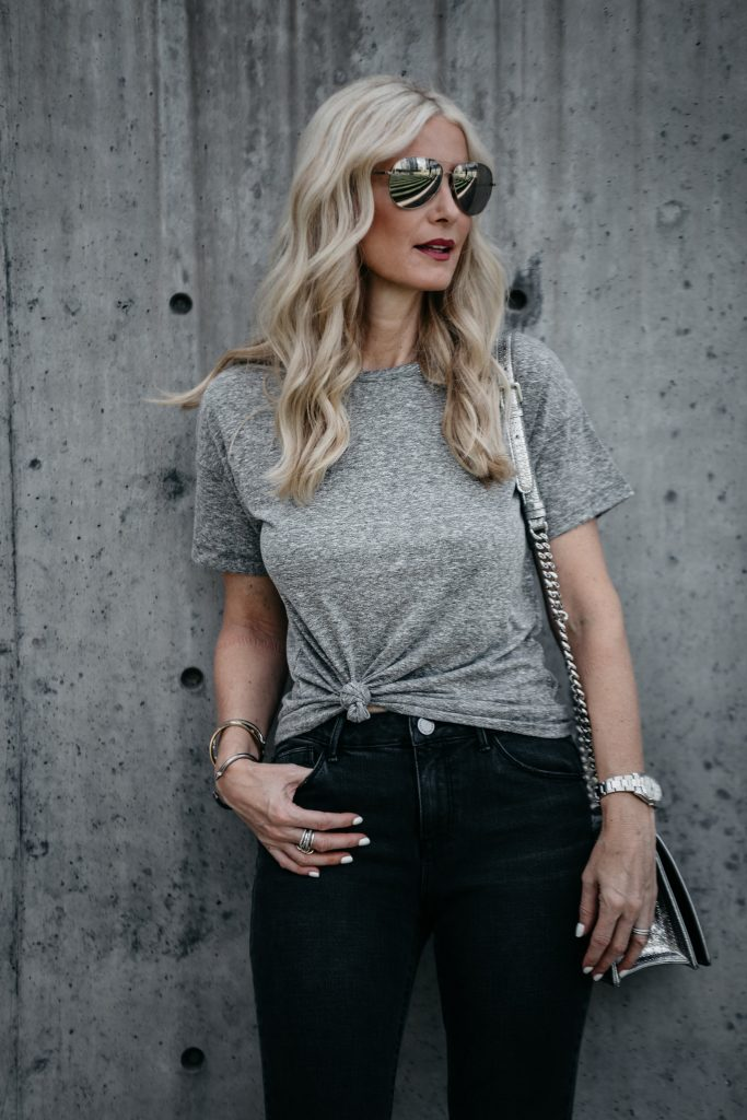 Dallas fashion blogger wearing gray tee and black denim