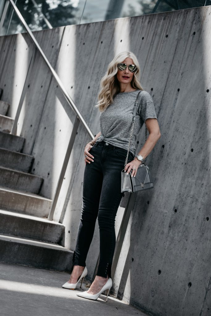 Gray tee, black jeans and white pumps