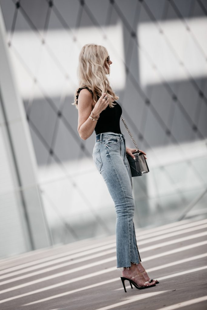 Dallas style blogger wearing Reformation bodysuit and Mother denim