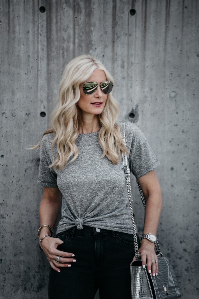 Dallas blonde wearing knotted gray tee
