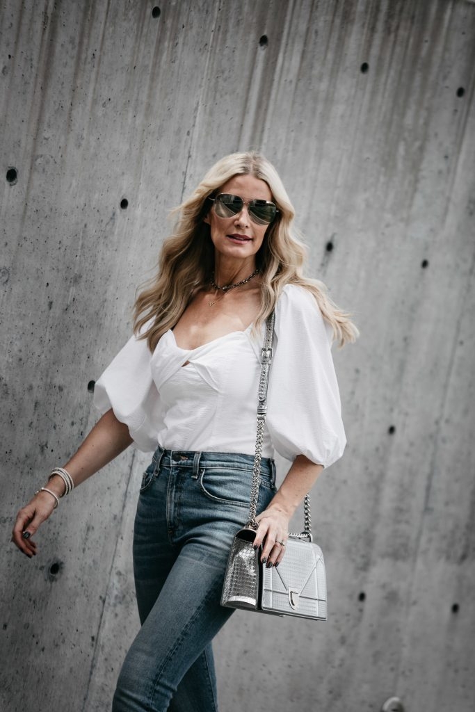 Dallas Style Blog wearing white top and jeans