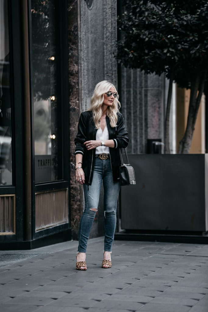 Dallas blogger wearing bomber jacket and Gucci Belt