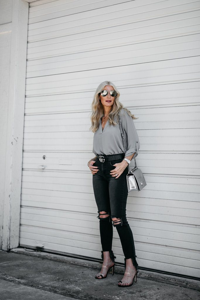 Dallas fashion blogger wearing L'agence black ripped jeans and heels
