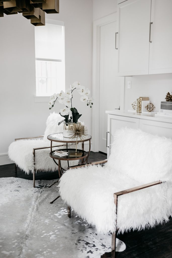 all white blogger office with faux fur chairs