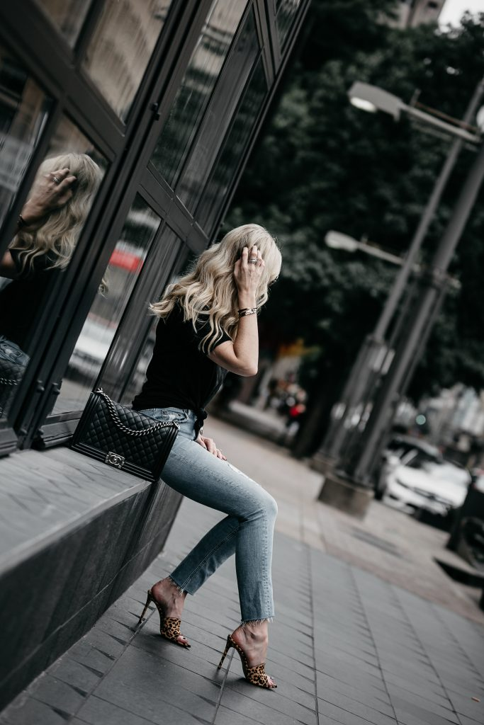 Dallas fashion blogger wearing Reformation jeans and leopard heels