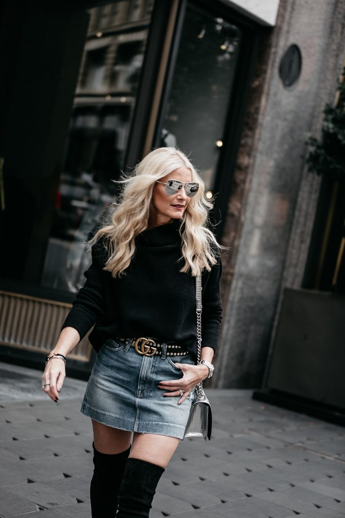 Dallas blonde girl wearing Gucci belt and black sweater