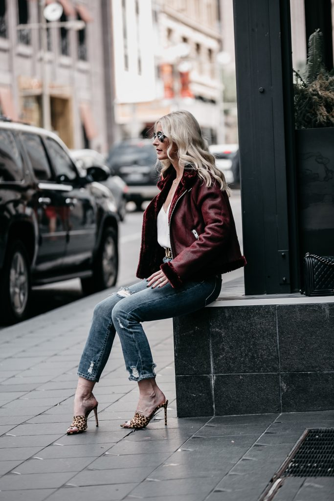 AOLA jeans, leopard heels, and faux shearling moto jacket