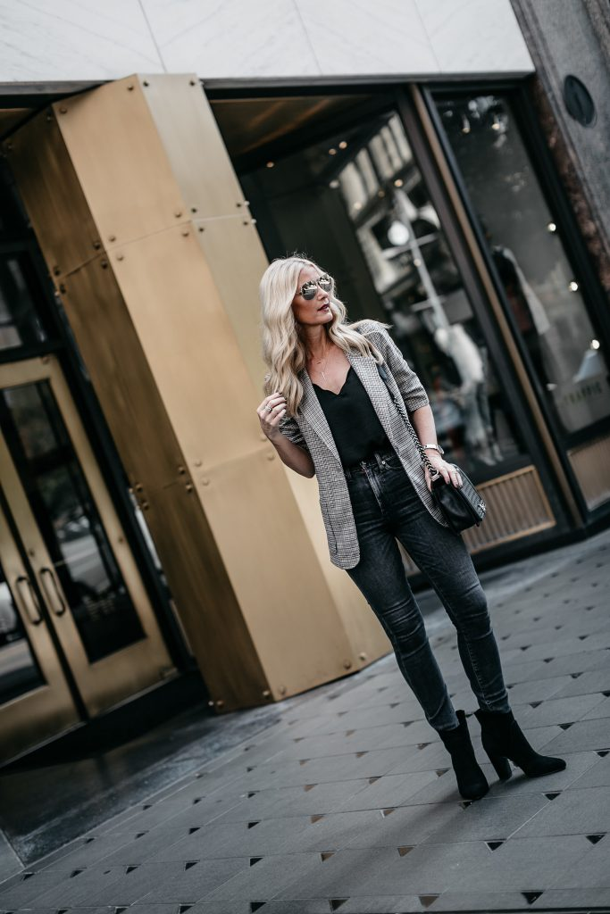 Dallas Style blogger wearing gray jeans, blazer, and ankle booties