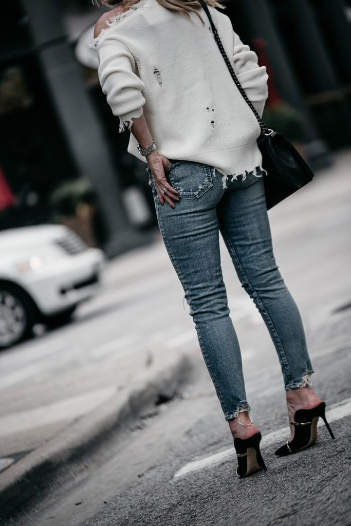 Dallas fashion blogger wearing ripped jeans and heels