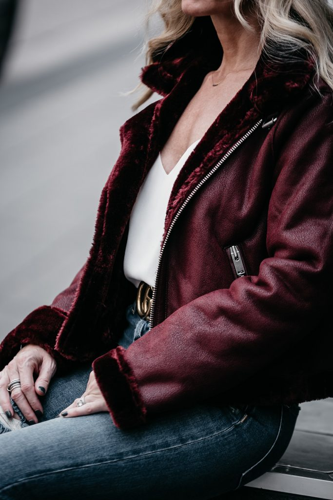 Dallas blogger wearing shearling moto jacket